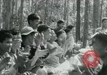 Image of Viet Cong political meeting at base in jungle Vietnam, 1965, second 26 stock footage video 65675032693