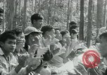 Image of Viet Cong political meeting at base in jungle Vietnam, 1965, second 27 stock footage video 65675032693