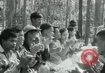 Image of Viet Cong political meeting at base in jungle Vietnam, 1965, second 28 stock footage video 65675032693