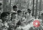 Image of Viet Cong political meeting at base in jungle Vietnam, 1965, second 29 stock footage video 65675032693