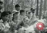 Image of Viet Cong political meeting at base in jungle Vietnam, 1965, second 30 stock footage video 65675032693