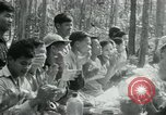 Image of Viet Cong political meeting at base in jungle Vietnam, 1965, second 31 stock footage video 65675032693