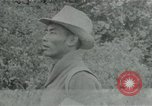 Image of Vietcong points 45 caliber automatic pistol Vietnam, 1965, second 1 stock footage video 65675032696