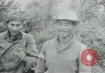 Image of Vietcong points 45 caliber automatic pistol Vietnam, 1965, second 12 stock footage video 65675032696
