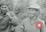 Image of Vietcong points 45 caliber automatic pistol Vietnam, 1965, second 13 stock footage video 65675032696