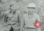 Image of Vietcong points 45 caliber automatic pistol Vietnam, 1965, second 23 stock footage video 65675032696