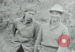 Image of Vietcong points 45 caliber automatic pistol Vietnam, 1965, second 24 stock footage video 65675032696