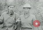 Image of Vietcong points 45 caliber automatic pistol Vietnam, 1965, second 28 stock footage video 65675032696