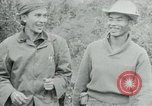 Image of Vietcong points 45 caliber automatic pistol Vietnam, 1965, second 30 stock footage video 65675032696