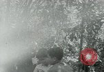 Image of Vietnamese families carrying food and supplies into Viet Cong camp in  Vietnam, 1965, second 4 stock footage video 65675032697