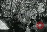 Image of Vietnamese families carrying food and supplies into Viet Cong camp in  Vietnam, 1965, second 13 stock footage video 65675032697