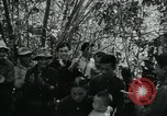 Image of Vietnamese families carrying food and supplies into Viet Cong camp in  Vietnam, 1965, second 16 stock footage video 65675032697