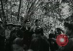 Image of Vietnamese families carrying food and supplies into Viet Cong camp in  Vietnam, 1965, second 17 stock footage video 65675032697