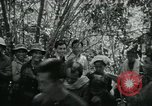 Image of Vietnamese families carrying food and supplies into Viet Cong camp in  Vietnam, 1965, second 18 stock footage video 65675032697