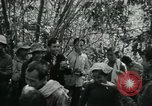 Image of Vietnamese families carrying food and supplies into Viet Cong camp in  Vietnam, 1965, second 19 stock footage video 65675032697