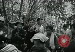Image of Vietnamese families carrying food and supplies into Viet Cong camp in  Vietnam, 1965, second 20 stock footage video 65675032697