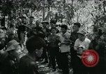 Image of Vietnamese families carrying food and supplies into Viet Cong camp in  Vietnam, 1965, second 22 stock footage video 65675032697