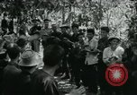 Image of Vietnamese families carrying food and supplies into Viet Cong camp in  Vietnam, 1965, second 24 stock footage video 65675032697