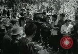 Image of Vietnamese families carrying food and supplies into Viet Cong camp in  Vietnam, 1965, second 26 stock footage video 65675032697