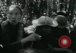 Image of Vietnamese families carrying food and supplies into Viet Cong camp in  Vietnam, 1965, second 38 stock footage video 65675032697