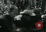 Image of Vietnamese families carrying food and supplies into Viet Cong camp in  Vietnam, 1965, second 42 stock footage video 65675032697