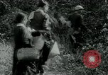 Image of Vietnamese families carrying food and supplies into Viet Cong camp in  Vietnam, 1965, second 60 stock footage video 65675032697