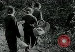 Image of Vietnamese families carrying food and supplies into Viet Cong camp in  Vietnam, 1965, second 61 stock footage video 65675032697