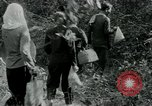 Image of Vietnamese families carrying food and supplies into Viet Cong camp in  Vietnam, 1965, second 62 stock footage video 65675032697