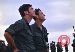 Image of 1st Air Cavalry division replacements watching helicopter demonstratio Vietnam, 1971, second 13 stock footage video 65675032698