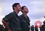 Image of 1st Air Cavalry division replacements watching helicopter demonstratio Vietnam, 1971, second 15 stock footage video 65675032698