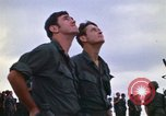 Image of 1st Air Cavalry division replacements watching helicopter demonstratio Vietnam, 1971, second 16 stock footage video 65675032698