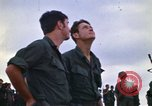 Image of 1st Air Cavalry division replacements watching helicopter demonstratio Vietnam, 1971, second 17 stock footage video 65675032698