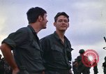 Image of 1st Air Cavalry division replacements watching helicopter demonstratio Vietnam, 1971, second 18 stock footage video 65675032698