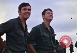 Image of 1st Air Cavalry division replacements watching helicopter demonstratio Vietnam, 1971, second 19 stock footage video 65675032698
