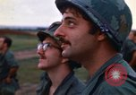 Image of 1st Air Cavalry division replacements watching helicopter demonstratio Vietnam, 1971, second 20 stock footage video 65675032698