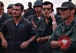 Image of 1st Air Cavalry division replacements watching helicopter demonstratio Vietnam, 1971, second 38 stock footage video 65675032698