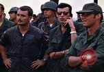 Image of 1st Air Cavalry division replacements watching helicopter demonstratio Vietnam, 1971, second 39 stock footage video 65675032698