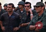 Image of 1st Air Cavalry division replacements watching helicopter demonstratio Vietnam, 1971, second 40 stock footage video 65675032698