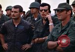 Image of 1st Air Cavalry division replacements watching helicopter demonstratio Vietnam, 1971, second 41 stock footage video 65675032698