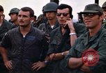Image of 1st Air Cavalry division replacements watching helicopter demonstratio Vietnam, 1971, second 42 stock footage video 65675032698