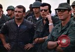 Image of 1st Air Cavalry division replacements watching helicopter demonstratio Vietnam, 1971, second 43 stock footage video 65675032698