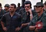 Image of 1st Air Cavalry division replacements watching helicopter demonstratio Vietnam, 1971, second 44 stock footage video 65675032698