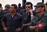 Image of 1st Air Cavalry division replacements watching helicopter demonstratio Vietnam, 1971, second 45 stock footage video 65675032698