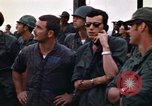Image of 1st Air Cavalry division replacements watching helicopter demonstratio Vietnam, 1971, second 47 stock footage video 65675032698