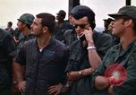 Image of 1st Air Cavalry division replacements watching helicopter demonstratio Vietnam, 1971, second 49 stock footage video 65675032698