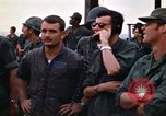 Image of 1st Air Cavalry division replacements watching helicopter demonstratio Vietnam, 1971, second 50 stock footage video 65675032698