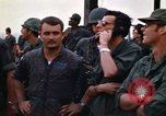 Image of 1st Air Cavalry division replacements watching helicopter demonstratio Vietnam, 1971, second 51 stock footage video 65675032698