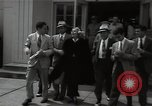Image of Mildred Gillars aka Axis Sally arriving for trial Washington DC USA, 1948, second 22 stock footage video 65675032739