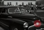 Image of Mildred Gillars aka Axis Sally arriving for trial Washington DC USA, 1948, second 32 stock footage video 65675032739