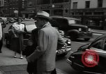 Image of Mildred Gillars aka Axis Sally arriving for trial Washington DC USA, 1948, second 43 stock footage video 65675032739